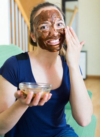 russian girl: russian girl applying mask for facial skin care Stock Photo