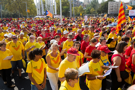 independency: BARCELONA, SPAIN - SEPTEMBER 11, 2014: Crowd of people singing at rally demanding independence for Catalonia in Barcelona, Spain Editorial