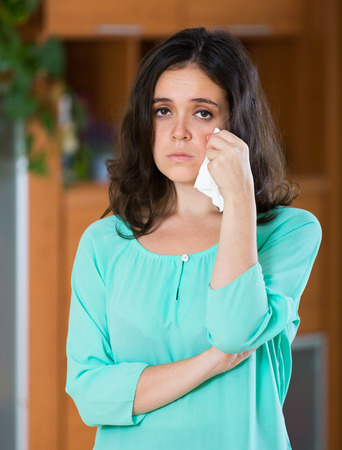 lonely: Upset lonely young brunette woman crying at home
