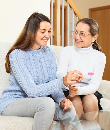 showed: mother happy pregnancy test showed her daughter at home