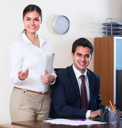to the secretary: Smiling businessman and secretary working in modern office Stock Photo