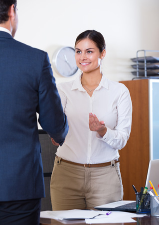 job interview: Smiling chief manager hiring assistant after job interview at office Stock Photo