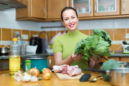 furnished: Portrait of female preparing dinner for family indoor