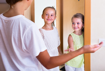 coming home: Cheerful little guests coming with friendly visit indoors