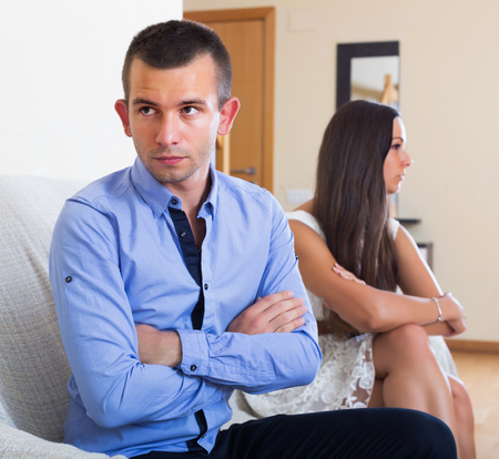 enmity: Angry young spouses having bad argue at home