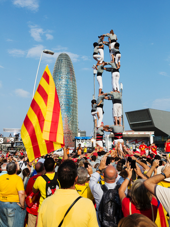 independency: BARCELONA, SPAIN - SEPTEMBER 11, 2014: Castellers performing Castells in National Day of Catalonia.  Castell - Catalan show is human tower built traditionally in festivals at Catalonia