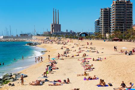 fabrica: BADALONA, SPAIN - MAY 23, 2015: Mediterranean sand beach in Badalona, Spain.  It is one of  centers of a beach holiday in Europe