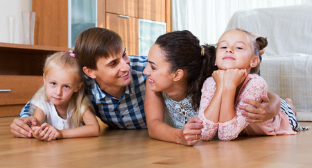 4s: Relaxed family of four posing in the domestic interior
