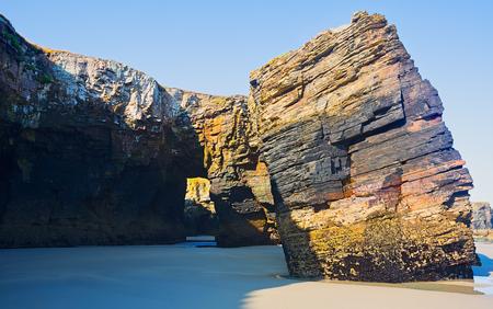 falling tide: Rocks  at As Catedrais beach durng low tide. Atlantic Ocean coast of Spain
