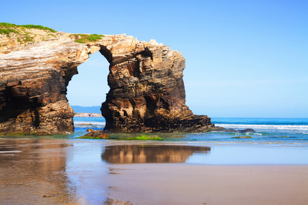 turistic: Natural arch at  As Catedrais beach - it is the turistic name of Praia de Augas Santas (Beach of the Holy Waters). Galicia Stock Photo