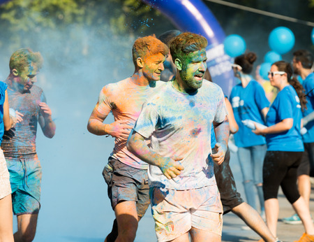 trituration: BARCELONA, SPAIN - JUNE 7, 2015: Happy dirty men running at The Color Run
