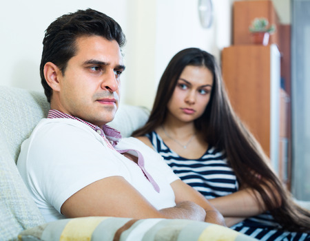 offended: Home conflict between offended husband and his young longhaired wife