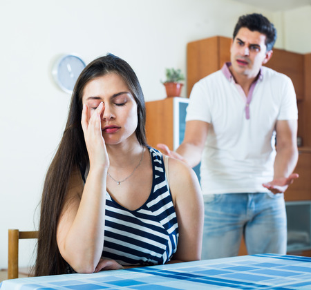 spouses: Angry young spouses having domestic argue at living room in home