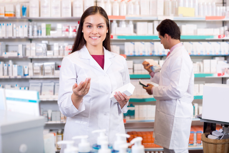 farmacy: Portrait of two smiling friendly pharmacists working in modern farmacy Stock Photo