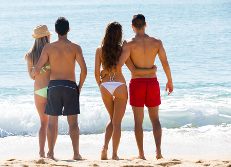 summer holidays: Positive young couples in love on romantic summer holidays vacation