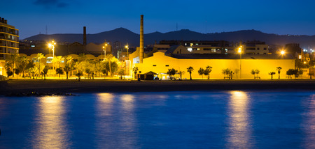 fabrica: Seaside of Badalona in evening. Catalonia