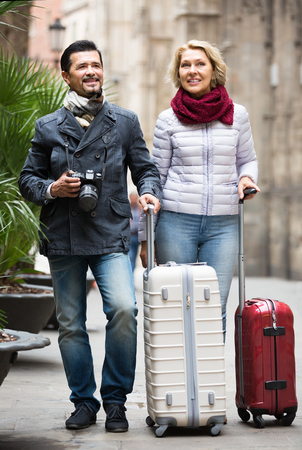taking a wife: husband and wife sightseeing and taking pictures around Stock Photo