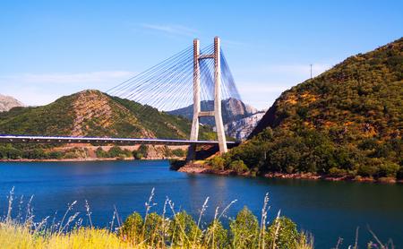 LUNA: Cable-stayed bridge over reservoir of Barrios de Luna in mountains of  Leon, Spain Stock Photo