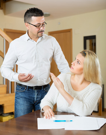 financial problems: Husband and sad wife having a financial problems Stock Photo