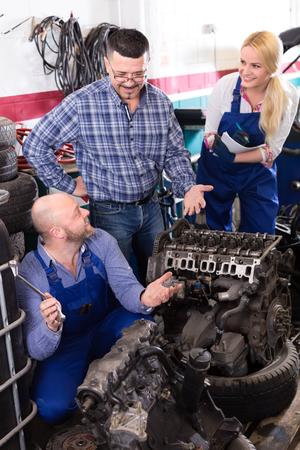 journeyman: Team of mechanics repairing engines in a workshop