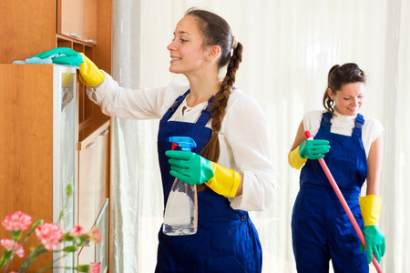 houseman: Happy female workers cleaning company ready to start work Stock Photo