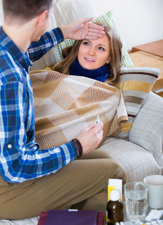 flue: Portrait of smiling sick girl with flue and nursing man indoors