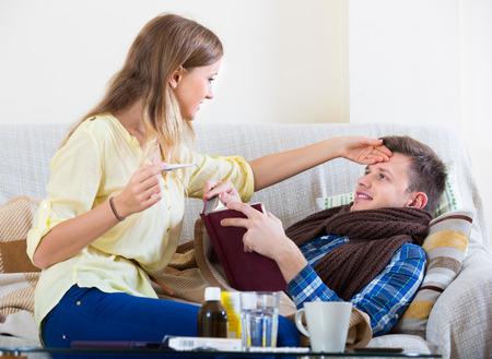 flue: Portrait of sick guy with flue and nursing girl Stock Photo