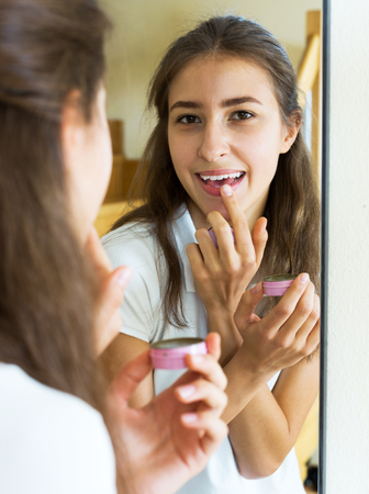 admiring: cheerful young girl admiring himself in front of the mirror Stock Photo