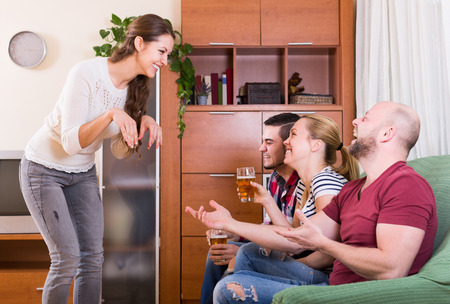 jokes: Positive adult friends hanging out with beer and jokes at home