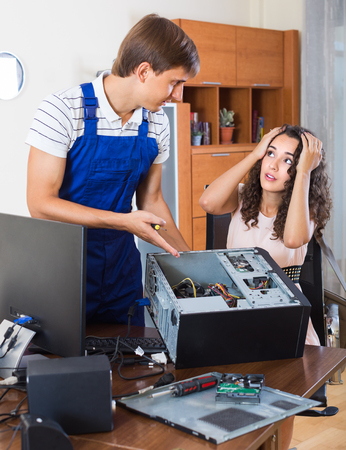 renewal: Expensive renewal of computer hardware, shocked client and engineer Stock Photo
