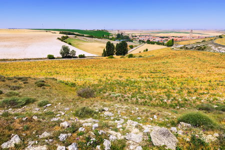 palencia province: European summer landscape with  village among fields.  Ampudia.  Province of Palencia, Castile and Leon, Spain Stock Photo