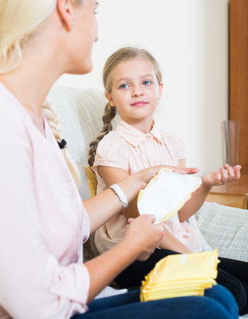 wingless: Confidential conversation between mother and daughter about menstruation Stock Photo