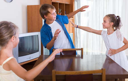 romp: Happy children playing romp game Touch-last at home Stock Photo