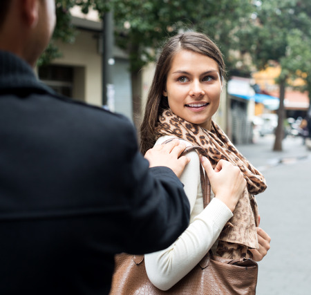 sidewalk talk: Adult asian man chasing beautiful girl and making offers outdoor Stock Photo