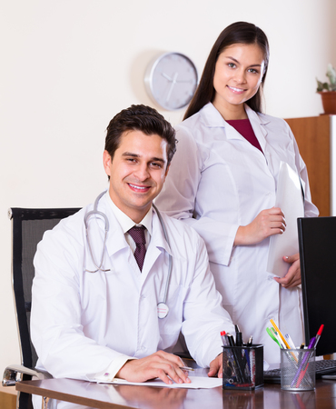 physiotherapists: Portrait of two professional doctors smiling in clinic
