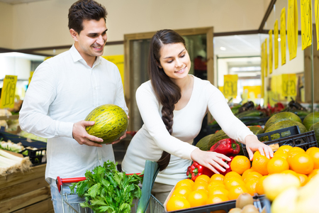 citrus family: russian family couple buying fresh seasonal fruits in market Stock Photo