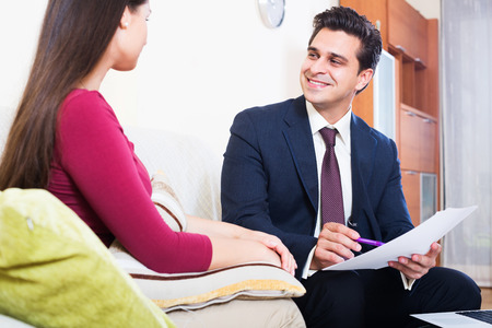 mortgage: Positive agent explaining customer mortgage agreement at home