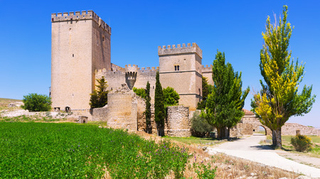 palencia province: Side view of medieval castle of  Ampudia in summer day.   Province of Palencia, Castile and Leon, Spain Editorial