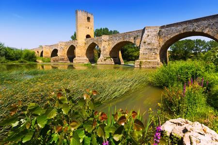 historical reflections: medieval stone bridge over Ebro. Frias, Province of Burgos, Spain