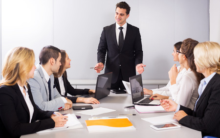 armenian woman: Adul and young business members of the multinational meetings in office. Focus on the man and right woman Stock Photo