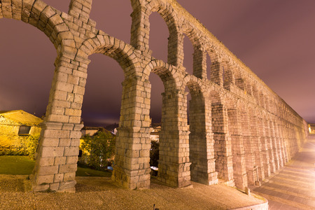 acueducto: Wide angle shot of  old Roman Aqueduct in night. Segovia, Spain