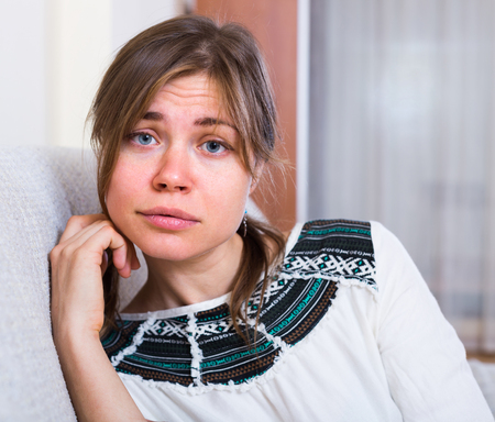 heartbreak issues: Portrait of miserable young brunette woman with hanging look Stock Photo