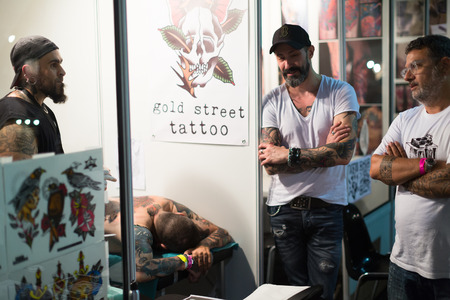 17th: BARCELONA, SPAIN - OCTOBER 3, 2014: Men at  17th edition of The Barcelona Tattoo Expo in Fira de Barcelona