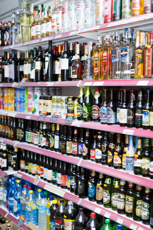 soft sell: BARCELONA, SPAIN - MARCH 22, 2015: Shelves with wine, beer and soft drinks at beverage section of average Polish supermarket in Spain