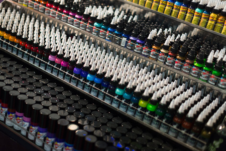 17th: BARCELONA, SPAIN - OCTOBER 3, 2014: Tubes of professional tattoo paint at showcase. The 17th edition of The Barcelona Tattoo Expo in Fira de Barcelona