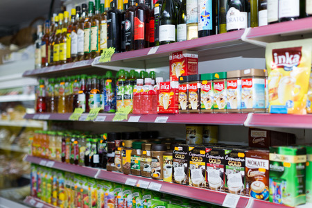 soft sell: BARCELONA, SPAIN - MARCH 22, 2015: Shelves with wine, cafe and soft drinks at beverage section of average Polish supermarket in Barcelona.