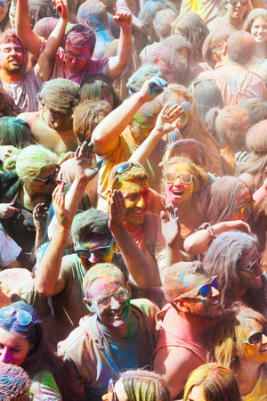 colores: BARCELONA, SPAIN - APRIL 12, 2015: Many happy dirty people at Festival de los colores Holy. It is traditional holiday  of Indian culture