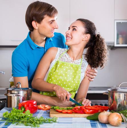 vegeterian: Positive vegeterian couple preparing soup with vegetables