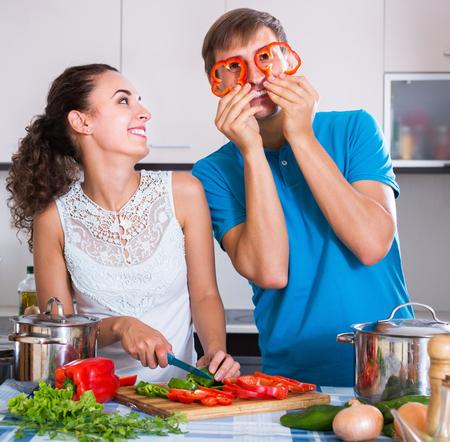 vegeterian: Happy family preparing vegeterian soup in domestic kitchen Stock Photo