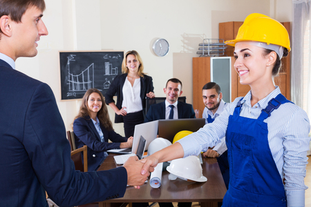 superintendent: The head of architecture bureau and american main specialist handshaking indoors Stock Photo